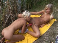 Alluring blonde lesbians shove dildos into each other's hot pussies