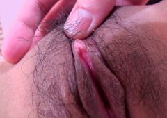Cute oriental student Nozomi Kahara pulls up her skirt for getting hairy tickled