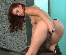 Sexy redhead Karlie Montana satisfies her sex hunger with nice dildo