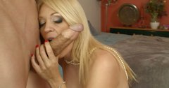 Leggy mature blonde Charlee Chase gives blowjob and titjob