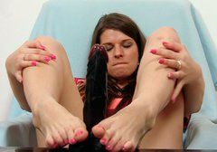 Horn made brunette Mona Lee strokes dildo with her feet
