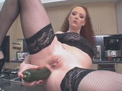 Audrey Hollander feeds her hungry pussy with cucumbers and sausages