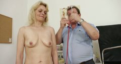 Dirty-minded blond hooker Isabela gets her hairy mature pussy examined and fingered