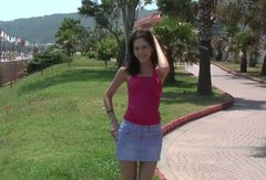 Cuddly girl takes you on walk in the resort area