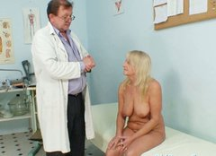 Busty old lady Dorota lies on the table while doctor checks her vagina