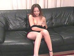 Perverted wanker Leah gets rid of black dress and masturbates on the couch