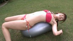 Naive Japanese teen Anna Nakagawa hops on a fit ball in bikini