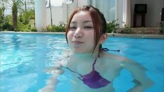 Salty Japanese hussy swims in pool in tiny bikini