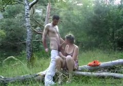 Grey haired slut sucks a stiff dick for sperm right in the woods