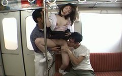 Dirty slut Saki Uchida is fucking two guys in a metro train
