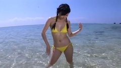 Divine Japanese hussy Rei Toda shows off her curves at the beach