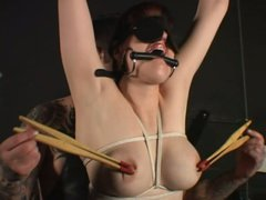 Tied and blindfolded brunette milf Snow feeling her nipples in pain