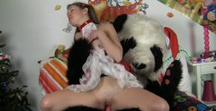 Extremely kinky girlie has anal sex with Santa Panda toy