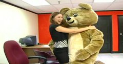 Dancing bear entertains girls in the office on a casual day