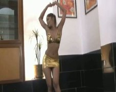 Skinny babe Tina performs Indian dance in bikini