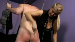 Mistress Nicolette brutally spanks her slave boy's chunky ass