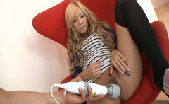 Curly dyed blond Asian Luka Sakurai gets her pussy stimulated with a sex toy
