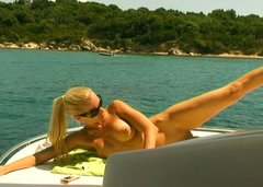 Obedient housewife Sandy takes a sun bath on the boat topless