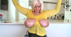 Plumpy milf Tiffany Blake shows off her jumbo sized juggs