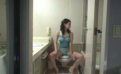 Skanky Japanese porn actress Maria Ozawa masturbates sitting on a toilet pan
