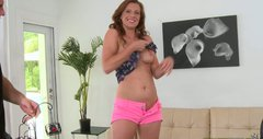 Seductive curly haired MILF gets on her knees to give a blowjob