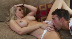 Julia Ann keeps her legs wide open and gets her pussy licked
