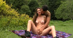 Chick with big ass Dany Elly rubs her wet pussy in the field