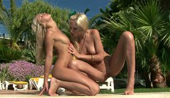 Blonde Logan and her girlfriend finger each other by the pool