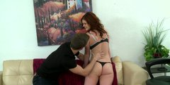 Cheerful curly haired hoochie gives blowjob on her knees