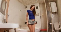 Slim and sexy brunette Sweet Lana gets naked in the bathroom