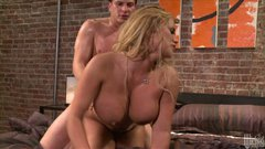 Outrageous blonde beauty Shyla Stylez fucks doggy style and rides dick