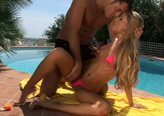 Fantastic and slim blonde Cayenne Klein blows dick by the pool