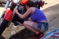 Slutty biker Ashton Pierce gives a stout blowjob in the garage