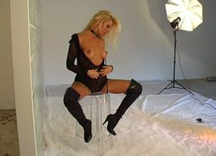 Slutty model Sandy poses naked and can't resist rubbing her clit