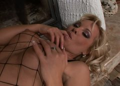 Kinky blond wanker Sharka Blue stretches her vulvar lips and stimulates clit