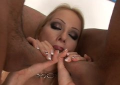 Tanned blond head Genevieve gives a nonstop blowjob to two cocks