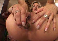 Flexible blond head Caroline Cage plugs a sex toy into her asshole