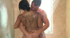 Brown skin whore Leilani Leeane gives a hot blowjob in a shower and delivers relaxing nuru massage