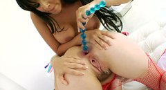 Trashy sluts Bobbi Starr and Diamond Kitty playing with a giant dildo and stretching their assholes