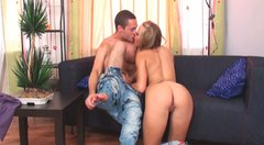 Curvy blonde beauty Molly McNicoll in white jeans gives blowjob and fucks doggystyle.