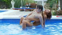 Sexy teen whores play in pool and tease each other