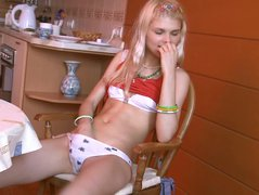 Blonde Loly fucks herself with a plastic bottle before her boyfriend comes in