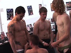 6 hot guys are hanging out in a booth at the street fair.