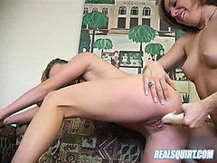 Two young lesbos getting naughty with a big dildo on camera