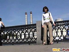 Chick wets her pants on a city embankment
