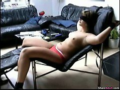 Hot blond girl is blind folded and tied on her chair and