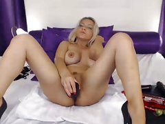 Busty blonde milf dildos pussy on webcam