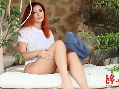 Lucy V seduces in her blue tight pants and white top.