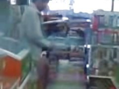 Thai guy jerking off in a store