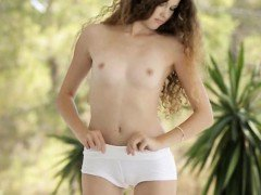 Curly haired teen cutie Vanessa shows her innocent pussy